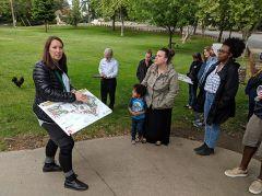 Melissa Ruth, an associate at Callander Associates, leads a group of Fair Oaks residents on a site walk, describing the project and gathering community input.