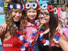 Isabella Simmons (left) 13, London Henry 8, and Janelle Germain 14, watched the parade in patriotic dress. Photo by Susan Maxwell Skinner