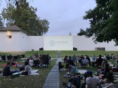 An outdoor audience is watching movies as Sutter's Fort for the summer. Photo courtesy of the Midtown Association
