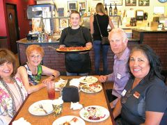 Julie Anderson employee of Del's Family Pizza brings a delicious pizza to multi chamber Power Lunch attendees. On the left: Rose Erickson, Fair Oaks Chamber of Chamber of Commerce Secretary; Diana Cralle a Tupperware Home Economist and member of Fair Oaks Chamber of Commerce; And on right: Victoria Ridge of Togo's Citrus Heights Chamber of Commerce Ambassador and Gary Spainhower, a chiropractor and member of the Rancho Cordova Chamber of Commerce. Photo by Patrick Larenas