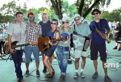 Famed Americana band Mumbo Gumbo drew huge crowds to Carmichael Park last weekend. Leader Tracy Walton (center with guitar) graduated from Mira Loma High. This weekend will feature the Dave Russell Band on Saturday and the Kiwanis Swing Band on Sunday.
