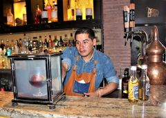 It's an 8-minute process concocting a Smoked Chocolate Old Fashioned, the signature drink of Qespi Bar inside the JW Marriott in Cusco. Photo by David Dickstein