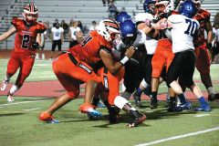 Senior Kenny Brown #44 tackles a Blue Devils runner. Photo by Rick Sloan