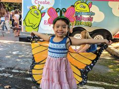 Five-year-old Serenity shows off her wings at the Grandparents Day Butterfly Release.