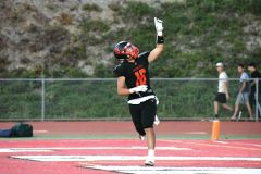 James Feao celebrates the 1st touchdown of the evening. Photo by Rick Sloan