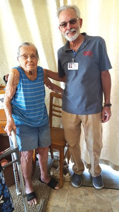 Thelma Wiltscire, just turned 100, poses with Meals on Wheels driver Patrick Quinn.