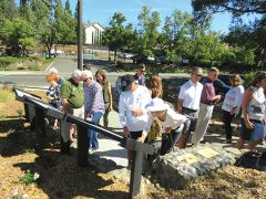 After the dedication attendees gathered to admire the project and read of the history of Fair Oaks.