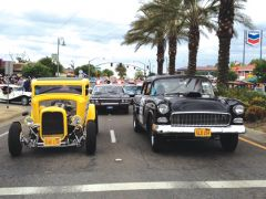 A yellow '32 Ford coupe and a '55 Chevy will be a Team Tribute for American Graffiti cars. Courtesy of Steve LaRosa Productions