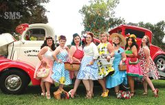 Pin-up culture models posed among vintage vehicles during Founders Day celebrations at Carmichael Park.  Showing a leg were Suzie Shortcake (left), Candy Apple Red, Sara Slushy, Cupcake Calamity, Devin De Ville, Bet D, Miss Sunshine and Petina Puppy. Photo by Susan Maxwell Skinner