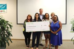 An ECMC Group board member joined ECMC Group employees to help present checks to organizations they nominated to receive a grant. Single Mom Strong, founded by Tara Taylor, was nominated by two employees. Photo courtesy ECMC Group