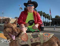 Marine Kelly Parks and companion Ingrid visit Sacramento Veterans Hospital, Mather.