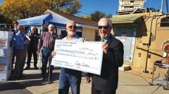 City of Rancho Cordova Mayor Robert McGarvey (right) presents a $10,000 check to CCFL Executive Director Walter Little as a donation for the annual Thanksgiving and Christmas food giveaways.