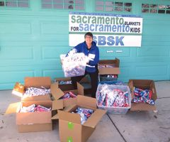 Sister Libby of Mercy Pedalers picks up toothbrushes from SBSK. Photo: SBSK